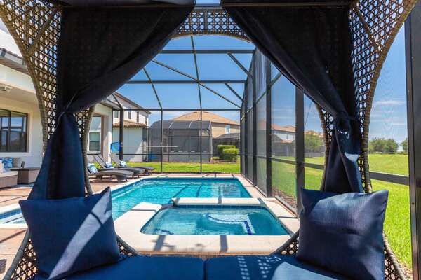Relax under the gazebo day bed with amazing views of Champions Gate