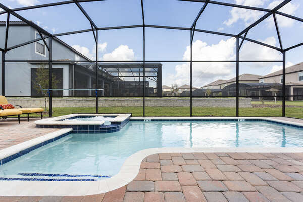 Spend all day enjoying your own private screened-in pool and spillover spa