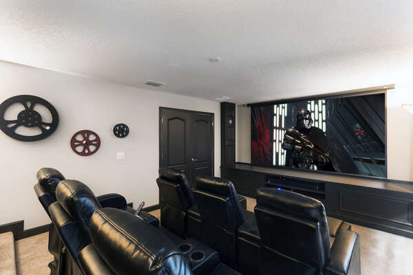 With a 12 ft. projection screen and 10 plush recliners, everyone will love watching movies in this Hollywood themed theater