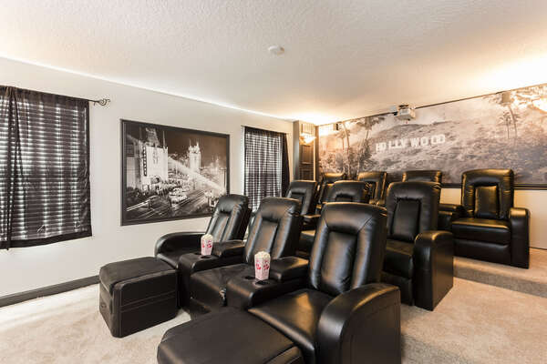 The whole family can gather together in the upstairs movie theater to watch favorite movies