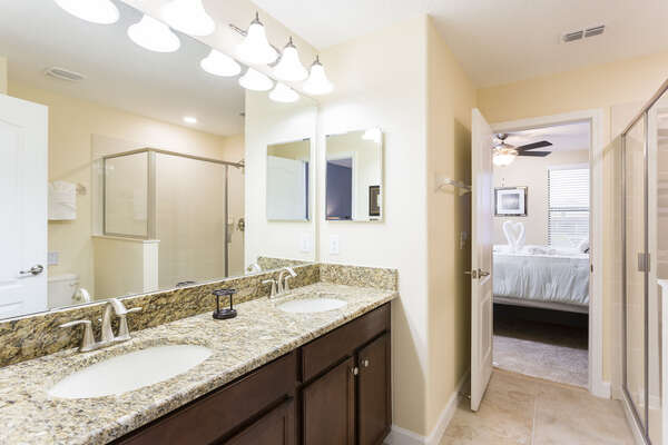 A jack and jill bathroom between two bedrooms