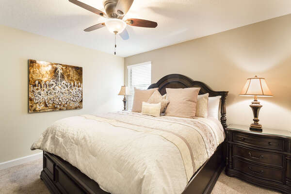 Head upstairs for the third bedroom, which features a king bed
