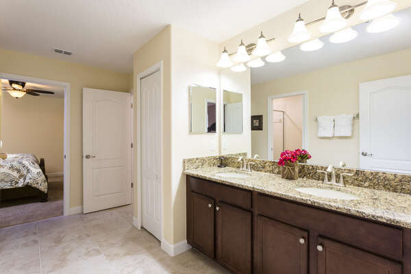 The ensuite master bathroom is very spacious and offers plenty of space to get ready