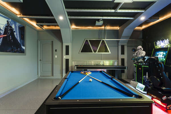 Unleash the force in this well equipped game room, complete with a pool table, shuffleboard, and fun arcade games
