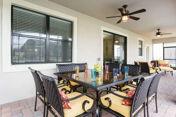 Dine al fresco underneath the covered lanai with seating for 8 outdoors