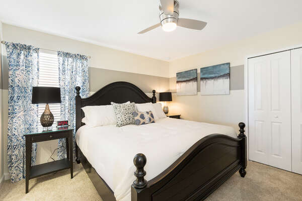 This master bedroom features a king bed located on the second floor