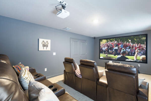 Enjoy the 120-inch projection screen in the second floor theater room with comfortable seating for 6