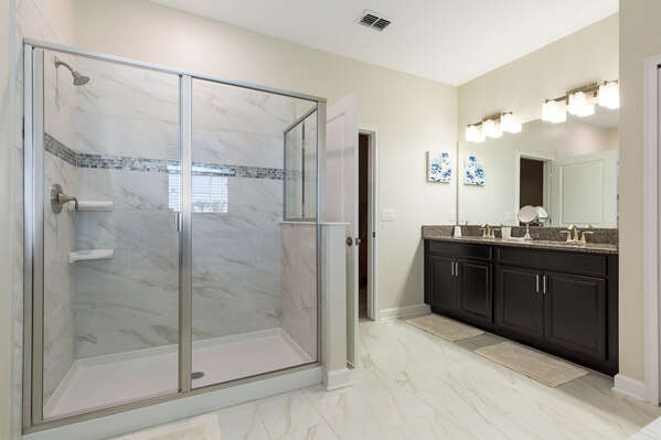 The master ensuite bathroom features dual vanity and walk-in shower