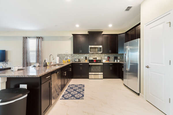 Make the most of the fully-equipped kitchen with stainless steel appliances