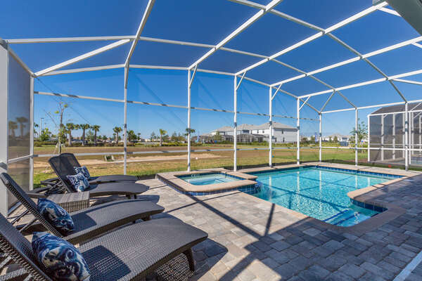 Enjoy the private screened-in pool area with sun loungers