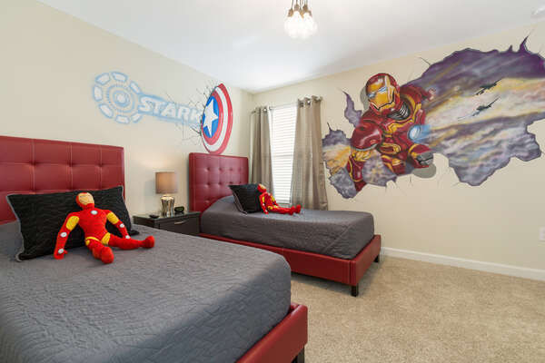 This kids bedroom upstairs features two twin beds perfect for superheroes