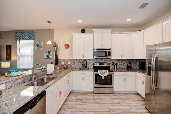 Fully equipped kitchen featuring stainless steel appliances is perfect for making family meals