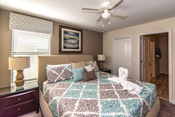 This bedroom features a King bed and access to the family bathroom upstairs