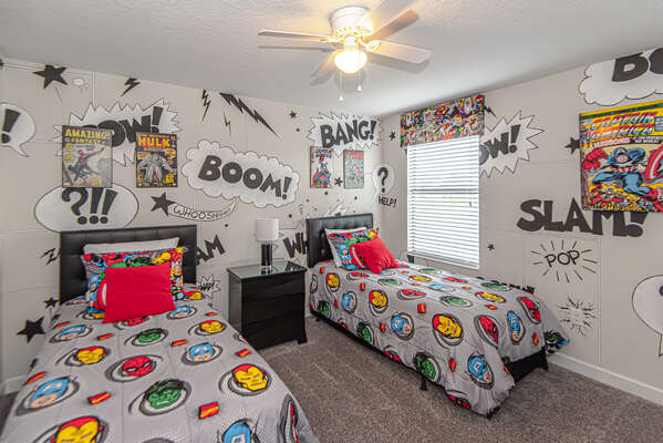This kid`s bedroom comes to life with comic book style artwork and two twin beds