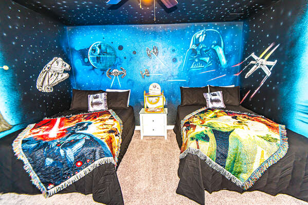 This galactic bedroom features 2 full beds
