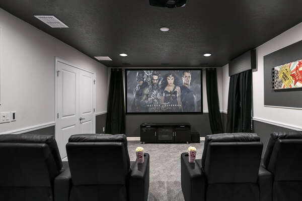 The second floor movie theater room has a 110-inch projection screen, surround sound, and stadium style seating for 9