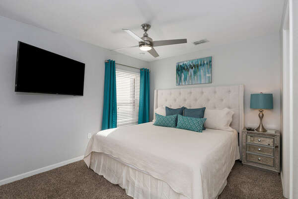 The third master suite located on the second floor features king size bed and 50-inch SMART TV