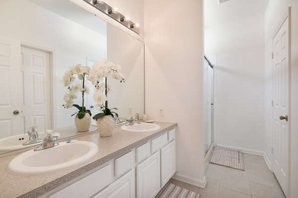 The ensuite bath has dual vanity and walk-in shower