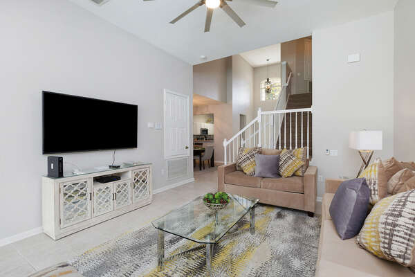 Sit back and relax after a long day in the theme parks in the spacious living area