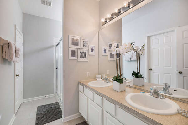 En-suite master bath with dual vanity and walk-in shower