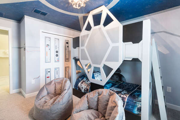 The kids bedroom features a custom built twin over twin bunk bed