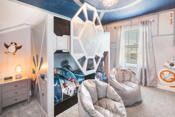 The kids will love their own custom galaxy bedroom