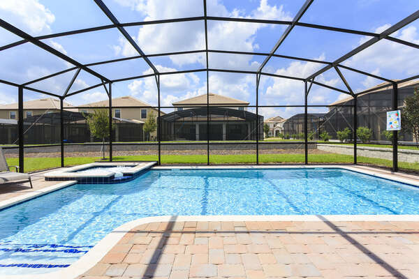 Spend your vacation relaxing at your private screened-in pool