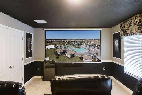 Pop some popcorn, sit back and watch a favorite movie on the 12 ft projection screen