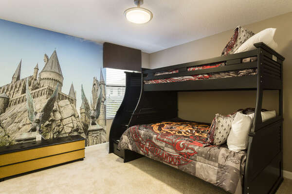 This magical bedroom features a twin over full bunk bed