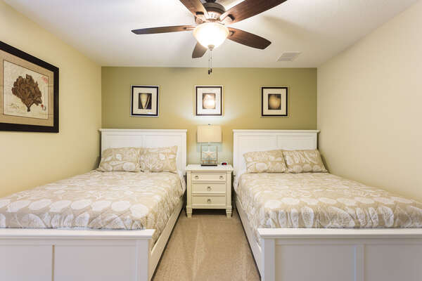 This upstairs bedroom features two full beds, perfect for teens and older kids to have their own space