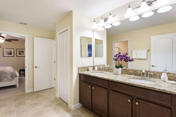 A jack and jill bathroom connects the two bedrooms