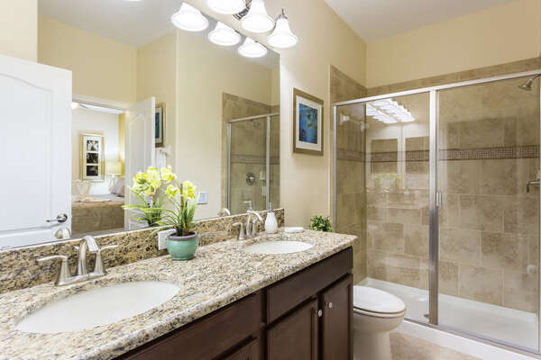 The ensuite master bathroom features a combo tub and shower
