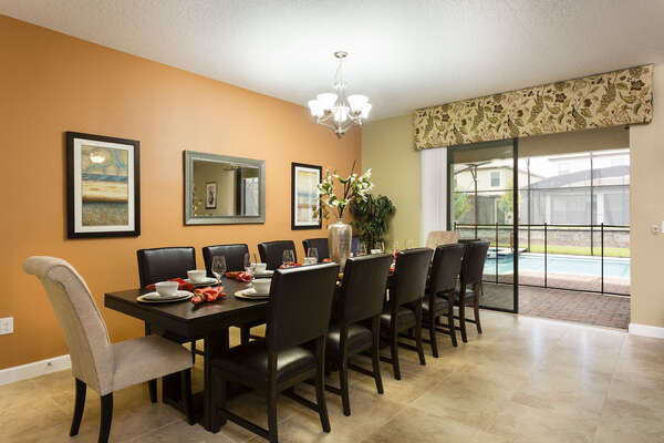 The whole family can dine together at the formal dining table with seating for 12