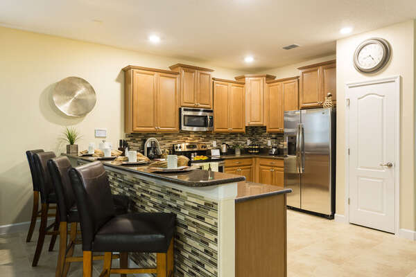 Enjoy a quick snack at the breakfast bar with seating for 4