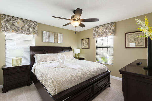 Upstairs king bedroom with neutral tones is great for relaxing