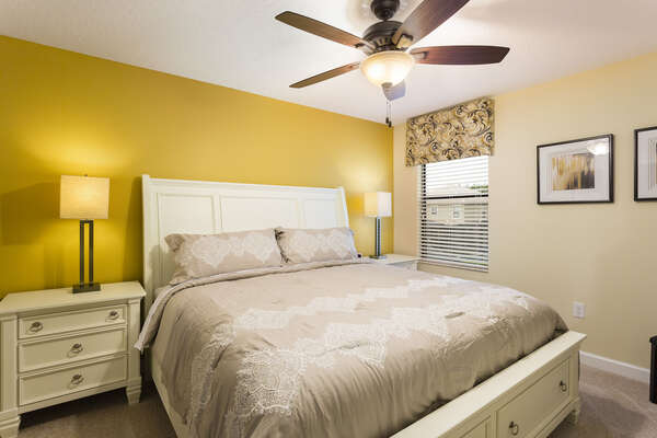 Head upstairs for this king bedroom decorated with inviting warm colors