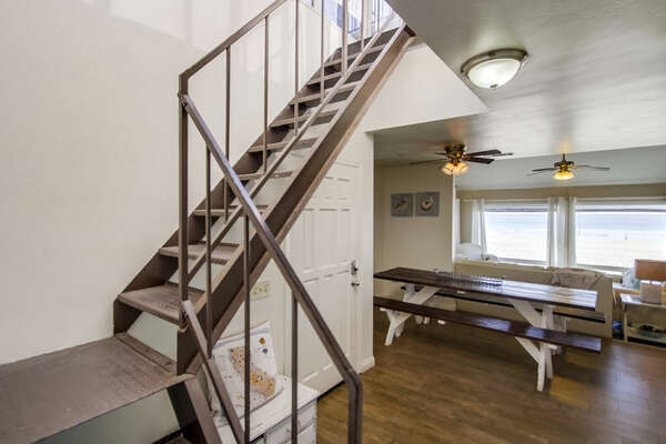 Stairwell to Third Level, Picnic Table, and Ceiling Fan.