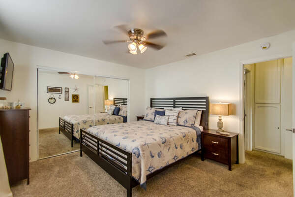 Large Bed, Nightstands, Dresser, TV, Ceiling Fan, and Mirror Closet Doors.