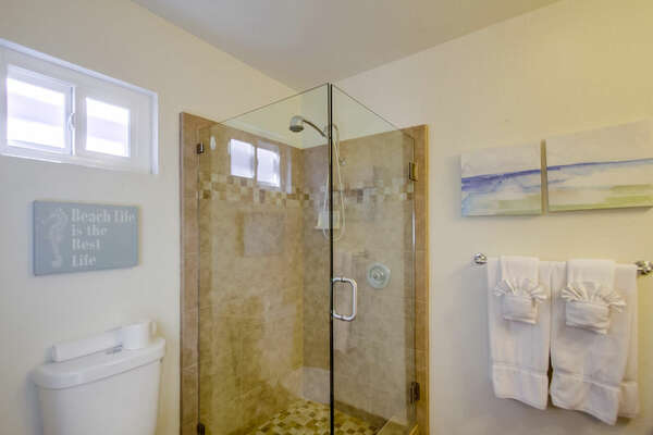 Shower with Glass Doors, and Toilet.