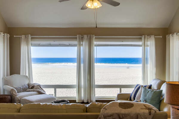 Living Area Windows with Ocean View, Arm Chair, and Sofas.