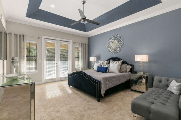 This master bedroom is spacious and has easy balcony access