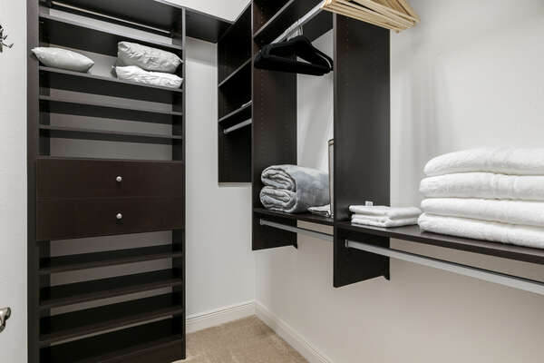 The master bedroom has a spacious walk-in closet