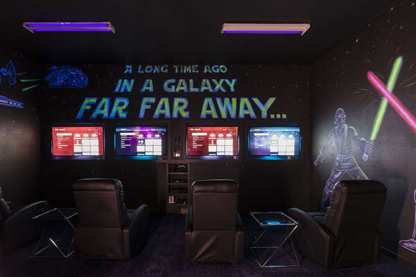 Everyone can enjoy their own movie or game on each TV in this amazing games room