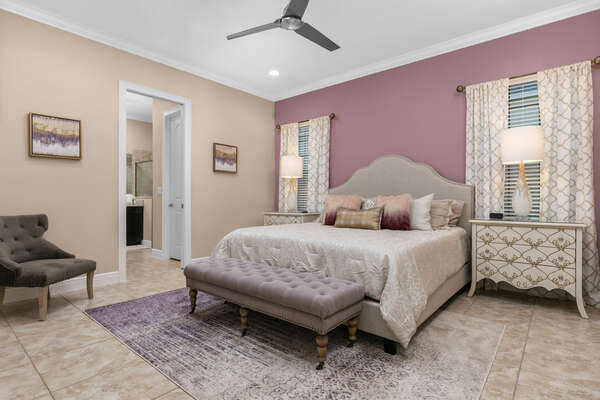 This ground floor bedroom features a beautiful king bed