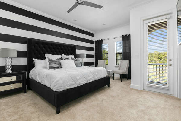 This second floor bedroom has another king bed and balcony access