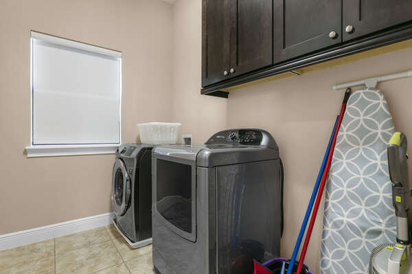 The laundry room has a washer and dryer