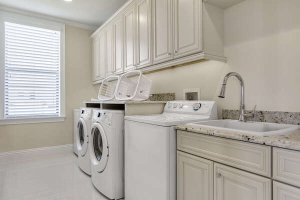 The laundry room has double washers and dryers to fit your large group