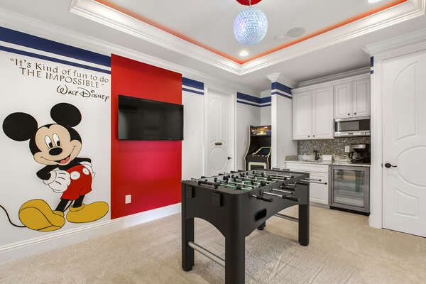 Fun third floor entertainment space with foosball table and arcade game