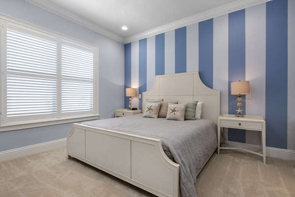 Vacation in the Destin Suite in this second floor bedroom with a king bed