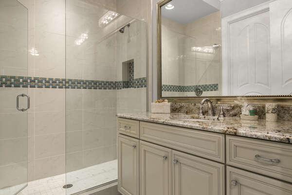 The en-suite bathroom has a walk-in shower built to match the suite